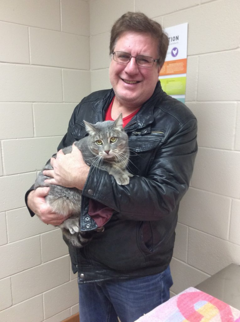 Owner holding Herbie the cat